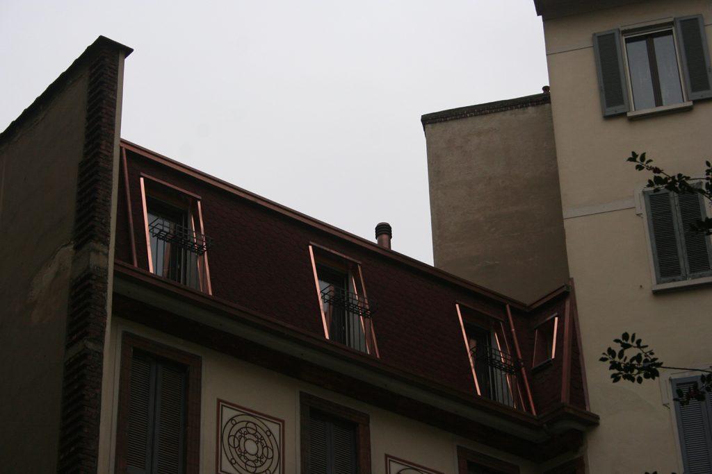 Recupero di sottotetto a fini abitativi di un edificio residenziale in via Sardegna | Milano